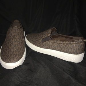 Brand new Michael Kors women's slip on's